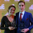 Joanne Allman, from Ballymacelligott, who won Volunteer of the Year, and Cillian Tierney, with the two awards he won, at the annual Triathlon Ireland Awards held in the Marker Hotel, Dublin last Saturday