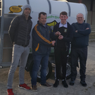 Chris Creedon is presented with the sheep trailer he won in the Gneeveguilla GAA fundraising draw. From left, are Liam Murphy, Patrick Barry, Chris Creedon and Tom Kerins