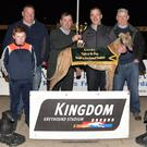 Chairman of the K.G.O.B.A. Johnny O'Keeffe, third from left, presents the winner's trophy to winning trainer/owner John O'Sullivan after Fibonacci won the K.G.O.B.A. Confined A7/A8 Stake final at the Kingdom Stadium on Saturday. Included, from left, are John and Jack Breen with Johnny O'Sullivan. Photo by www.deniswalshphotography.com
