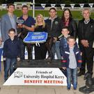 Padraig Mallon, Kerry Group, presents the winner's trophy to winning owner John Houlihan, Ballyduff, after Misty Supreme won the Kerry Group Hospital Sweepstake Final at the University Hospital Kerry benefit night at the Kingdom Stadium on Friday. From left are PJ Hayes. Kieran Casey, Nora Kelly, Jack Houlihan, Geraldine Enright, Wiliam Houlihan, Maireád Houlihan, Michael Houlihan, Noel Somers, with Michael and Christopher Houlihan. Photo: www.deniswalshphotography.com