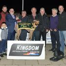 Chairman of the K.G.S.S.C. Murt Murphy presents the winner's trophy to winning owner Noel Power (Ballyduff) after Jasons Fifi won the K.G.S.S.C. Stakes final at the Kingdom Greyhound Stadium on Friday night. Included, from left, Andrew Sheehy, Denis Moriarty, James O'Rourke, Caleb O'Rourke, Patsy O'Rourke, Chris Houlihan, Christy Donovan and Kieran Casey, KGS Racing Manager. Photo by www.deniswalshphotography.com