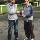 Kerry Motor Club's Auto Solo clerk of the course presents Daniel Chung with his KK Hydraulics championship trophy. Photo by Kerry Motor Club