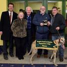 Murt Murphy, KGSSC chairman, presents the winner's trophy to winning trainer/owner John Sugrue from Cahersiveen after Fermoyle Trump won the K.G.S.S.C. Stake Final for A4 greyhounds at the Kingdom Greyhound Stadium on Friday night. Included, from left, are Decal Dowling, KGS Manager, Teresa and Liam Holohan, breeders, and Kieran Casey, KGS Racing Manager. Photo by www.deniswalshphotography.com