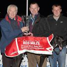 John Geoghegan, representing Red Mills, presents the winning trophy to winning trainer/owner Brendan O'Shea (Millstreet) after Crossfield Liz won the Red Mills Unraced Bitch Stake Final at the Kingdom Greyhound Stadium on Friday night. Included, from left, are Kieran Casey (racing manager), Rafal Polszak (handler) and Declan Dowling (KGS manager). Photo by www.deniswalshphotography.com