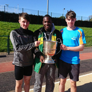Tralee Harriers athletes, from left, Cillian Griffin, Travane Morrison and Luke O'Carroll with the Quill Cup