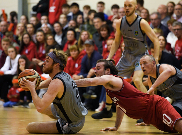 Darragh O'Hanlon of Garvey's Warriors Tralee in action against Stephen James of Templeogue during the Hula Hoops Pat Duffy Men's National Cup match between Templeogue and Garvey's Warriors Tralee at Oblate Hall in Inchicore, Dublin. Photo by Sportsfile