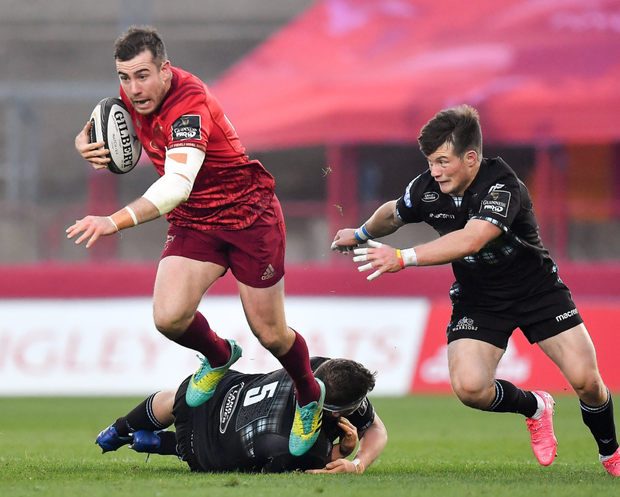 JJ Hanrahan of Munster is tackled by Scott Cummings of Glasgow Warriors during the Guinness PRO14 Round 7 match between Munster and Glasgow Warriors at Thomond Park on Saturday evening. Photo by Brendan Moran/Sportsfile