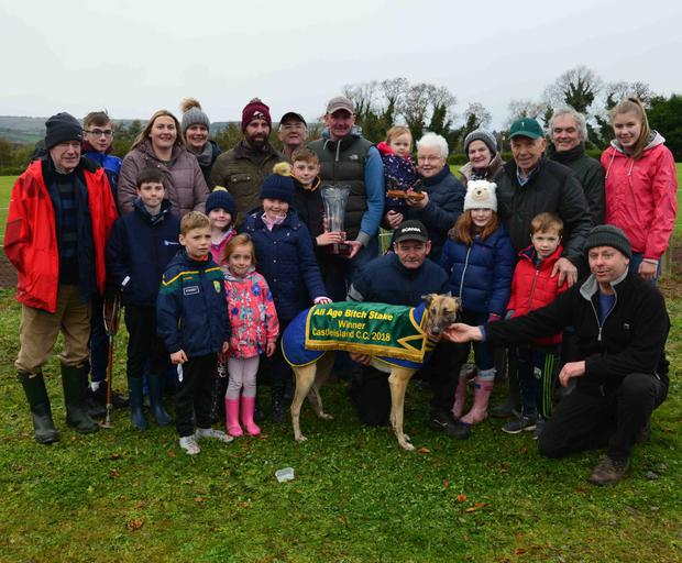 Tom Nolan and Margaret Nelligan presenting the Cup to Jack Nolan after his dog, Silent Wonder, won the All Age Bitch Stakes at Castleisland Coursing on Monday