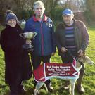 It was a Kerry victory at Newcastlewest coursing when Doneen Cathy won the Oaks trial stake for owners Nick Cotter and John Walsh from Knocknagoshel seen here receiving the cup from sponsor Nora Raleigh. Photo by Moss Joe Browne
