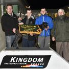 KGS manager Declan Dowling presents the winner's trophy to Diarmuid Lynch on behalf of the winning owners after Ballymac Gina won the Kingdom Stadium Novice Sprint Stakes Final at the Kingdom Stadium on Friday night. Included are Stephen Reidy and Micky Reidy. Photo by www.deniswalshphotography.com