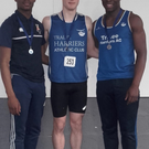 Cillian Griffin and Basit Oyebanji from Tralee Harriers on the podium after the U18 men's 80m.