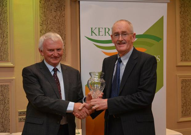 Martin Fitzgerald presenting the trophy to the Hall of Fame winner Mike OConnor