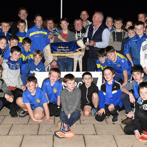 Eoin O'Mahony (committee member) presents the winner's trophy to Lacey Kerins after Confident Rodman won the LB Rovers FC Stakes Final at their Fundraiser at the Kingdom Stadium on Saturday night. Included are the many members of the LB Rovers FC and members of the organising committee, trainer Padraig Regan, owner Jeremiah Kerins (centre) and Declan Dowling (KGS Manager). Photo by www.deniswalshphotography.com