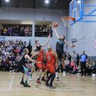 Rap Buivydas gets a hand in to rebound for Garvey's Tralee Warriors in their National Cup quarter-final win over Killester in the Tralee Sports Complex