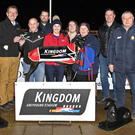 Declan Dowling (KGS manager) presents the winner's trophy to owner Tommy Hegarty after Allowdale Shelly won the Kingdom Stadium ON3 Stake 525 final last Friday. Included, from left, are Mary and Garry Pepper, Damien Pepper, Olivia Roche, Evah Hegarty, Áine McCarthy Roche (former owner/trainer), Kieran Casey (KGS racing manager), and Seanie McMahon. Photo by www.deniswalshphotography.com
