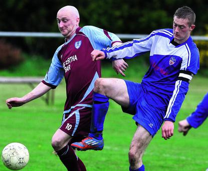 n Skeliga FC's Stevie Boyle (left) and Shanakill Athletic captain, Robert Lynch, tussling for possession during their Kerry District League Division 2A League final at Mounthawk Park on Sunday afternoon. Photo by John Reidy