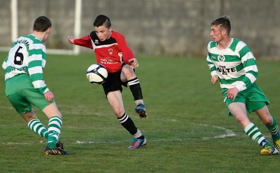 The Park's Adam O'Rourke trapping this ball under pressure from Killarney Celtic's Matt Keane (no.6) and Darren Doherty during their drawn KDL Youths' League Final at Mounthawk Park on Friday evening. Picture: John Reidy.