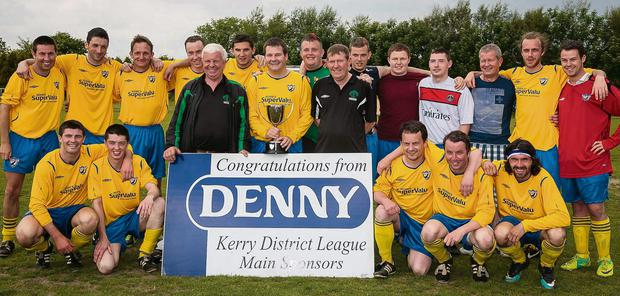 Front l-r: Shane McSweeney, Lar O'Connor, John Regan (FAI), Kieran O'Shea (capt), Sean O'Keeffe (FAI), Mike Kelliher, Paul McKenna and Karl Falvey. Back l-r: Aidan O'Connor, Johnny Carey, Jerry O'Brien, Sean Costello, Ryan Keane, Chris O'Connor, Alan O'Connor, Lee Carey, Dillon Carey, Mike Griffin (manager),Gary Cahillane and Mitchell O'Sullivan. Photo: Paul Tearle