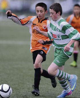 Darren Looney Killarney Celtic gets ahead of Raul Vengzel St. Brendan's Park in the Kerry Schoolboys U14 Division 1 at Celtic Park Killarney on Saturday.