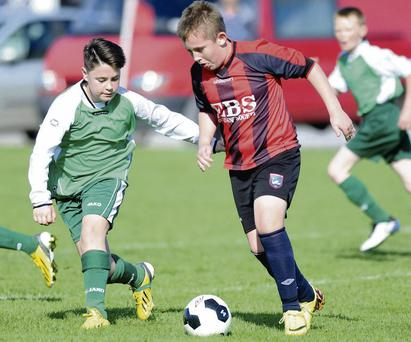 Cian O'Mahony Mastergeeha in possession against Aaron Daly Shelbourne Limerick in the Under-13 National Cup at Mastergeeha FC, Kilbrean, Killarney on Saturday.