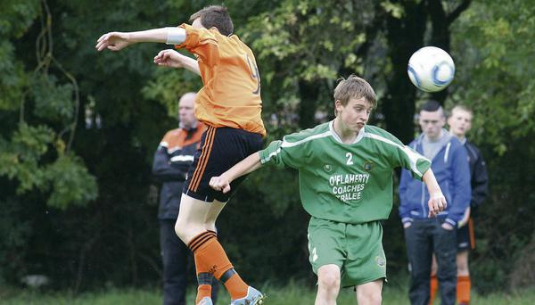 Granville Rovers, Aaron Murphy and Castleisland's Andrew Tees contesting this ball during Saturday's FAI U-16 cup game in Castleisland. Photo: John Reidy