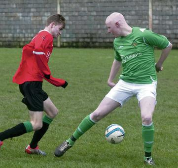 Ballyhigue's Pat McElligott tries to stop St Brendans Park's Jessie O'Sullivan in Tralee on Saturday.