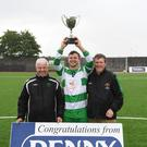 Killarney Celtic captain Stephen Hayes with the Cup after his team won the KO Cup title. Also in picture is John O'Regan and Sean O'Keeffe of the KDL. Photo by Domnick Walsh / Eye Focus