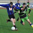 Darran Coleman, Ballymac Celtic (blue), and Tom McCarthy, Sporting Listowel, in Division 1B action at Mounthawk Park. Photo by Domnick Walsh