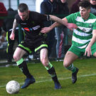 Wayne Sparling, Killarney Celtic, putting pressure in Declan Downes, Northland United in the FAI final sixteen at Celtic Park, Killarney on Sunday