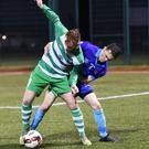 Stephen McCarthy, Killarney Celtic, comes under pressure from Rian O'Sullivan, Dingle Bay Rovers, at Celtic Park, Killarney on Friday. Photo by Michelle Cooper Galvin