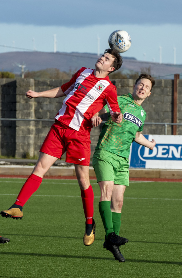 Limerick Desmond League player John Hayes gets his head to the ball ahead of Kerry's Kevin O'Sullivan during their Oscar Traynor Cup clash in Mounthawk Park on Sunday. Photo by Domnick Walsh