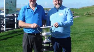 Eddie Hanafin, winner of the Blocworx Golfer of the Year at Castlegregory Golf Club being presented with his trophy by Colin O'Sullivan, Captain.