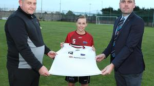 Drogheda Town FC captain Emma Tuite with manager Andrew Matthews and Barry McDermott of club sponsors Apex Fire.