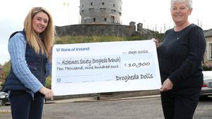 Natalie Kelly of Drogheda Dolls presents a cheque to Ann Shortt of the local Alzheimers Society.