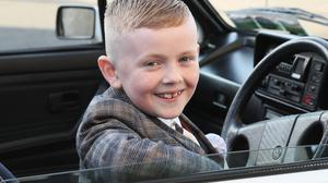 Callum Devine arrived in a classic convertable VW for his first communion day in Collon