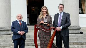 Fionnuala Donlon with her father Padraig and President Michael D. Higgins