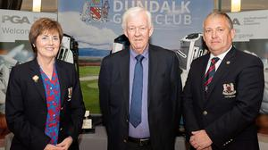 Michael McCumiskey (centre) with Dundalk Golf Club's Lady Captain Pauline Campbell and Captain Trevor Giff.