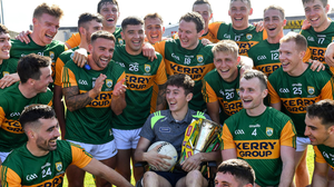 Injured Kerry footballer Seán O'Leary joins teammates for a photograph after the Munster final win.