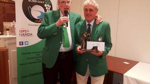 Eddie Maguire (right) receives a presentation from Philip Bond - brother of legendary Offaly hurling manager Michael Bond - following his win at Stackstown.