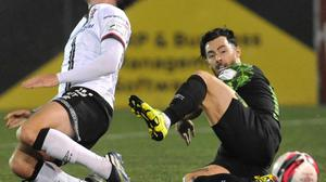 Will Patching, Dundalk is fouled by Richie Towell, Shamrock Rovers during the Premier Division League game in Oriel Park. Photo: Aidan Dullaghan/Newspics