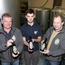 Liam Doyle, Jack Doyle and Doug Taylor with their bottled beer