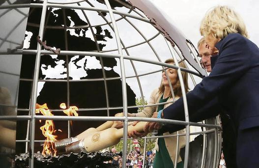 Jean Kennedy Smith, An Taoiseach Enda Kenny and Caroline Kennedy lighting the Emigrant Flame on the quay in New Ross last June.