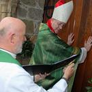 Bishop Denis Nulty opening the doors at Duiske Abbey assisted by Graiguenamanagh PP Fr Gerry Byrne