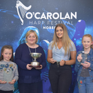 The winning team in the Harps Wonder Competition at the O'Carolan Festival with Aileen Kennedy. From left, Niamh Byrne, Hilda Browne and Caoimhe Moran