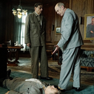 Joseph Stalin (Adrian McLoughlin) lies dead on the floor while Malenkov (Jeffrey Tambor) and Khrushchev (Steve Buscemi) discuss what to do next in The Death Of Stalin
