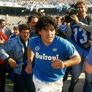 Diego Maradona takes to the field for his club Napoli