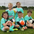 Enjoying the the FAI Summer Soccer School in Campile last Wednesday were (front) Sarah Cummins, Ryan O Connor and Sean Brennan; (back) Cillian Parker and Ali Kavanagh