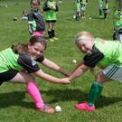 Joanne Shallow and Mia Ryan having fun at the Kellogg's Cúl Camp at St James GAA grounds