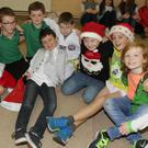 2nd and 3rd class pupils from Danescastle NS relaxing after their Christmas concert in Bannow Parish Hall