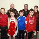 Boxers from St. Michael's club, New Ross at the recent boxing tournament in Gorey, pictured with their coaches, Michael Richardson and Bosco Greene